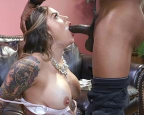 Busty naked girl guzzles the huge black shaft