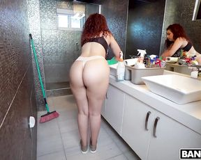 Young maid with curly red hair likes cleaning up the toilet being half naked