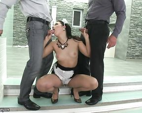 Experienced maid shows men how she can suck naked cocks at once