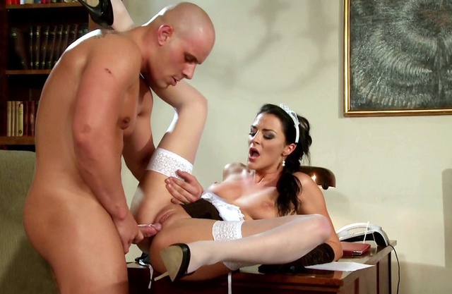 Maid in white stockings lies on the table and bald guy fucks naked twat