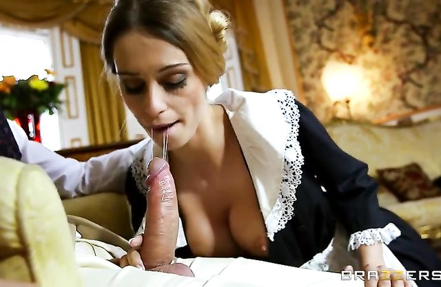Gentleman sits on armchair and maid with naked tits gives him blowjob