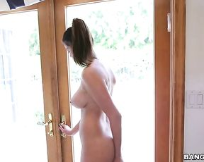Latina maid with pierced naked nipples goes outside and cleans the window