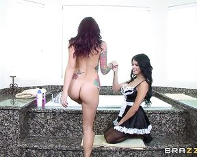 Brunette maid helps busty woman wash naked body using pink sponge