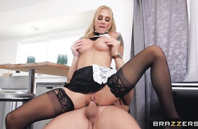 Tattooed maid in black stockings rides boy's naked penis like pro