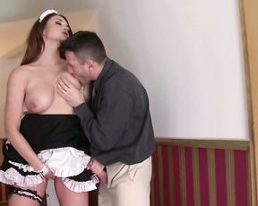 Enticing pin up maid with red hair enjoys naked cock of guy who hired her