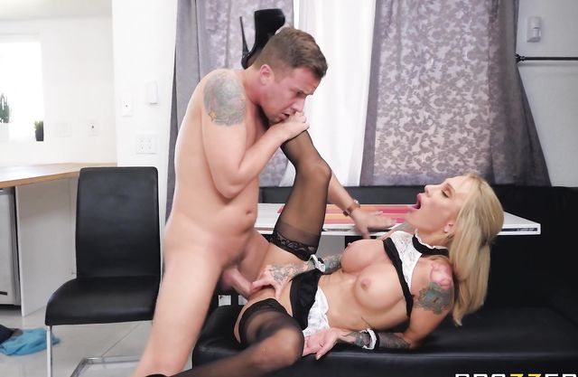 Busty maid with tattooed hands is fucked in naked pussy and facialized