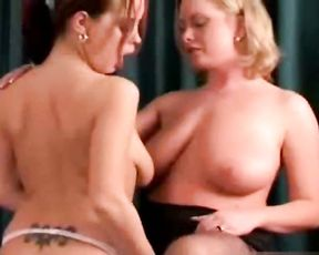 Naked sex is the way busty blonde relaxes on sofa with red-haired girl