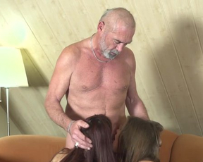 Old man takes part in group fun with two naked and unsatisfied girls