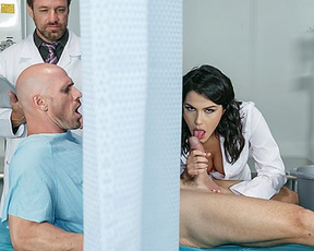 Sexy nurse girl sneakily sucks patient's naked dick behind curtain