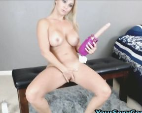 Busty naked girl actively masturbates moist pussy during cam show