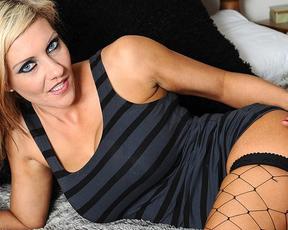 Naked blonde in fishnet black stockings enjoys blue vibrator in pussy