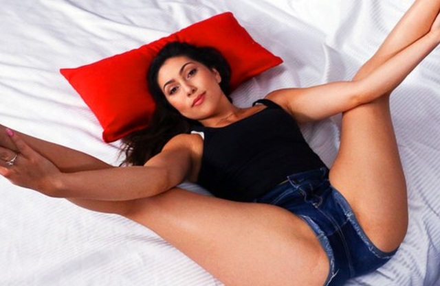 Girl in jean shorts makes it orally with naked cameraman in bed