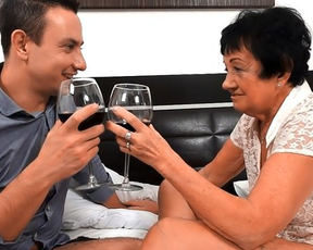 Young crusher drinks wine and fucks pussy of old naked brunette