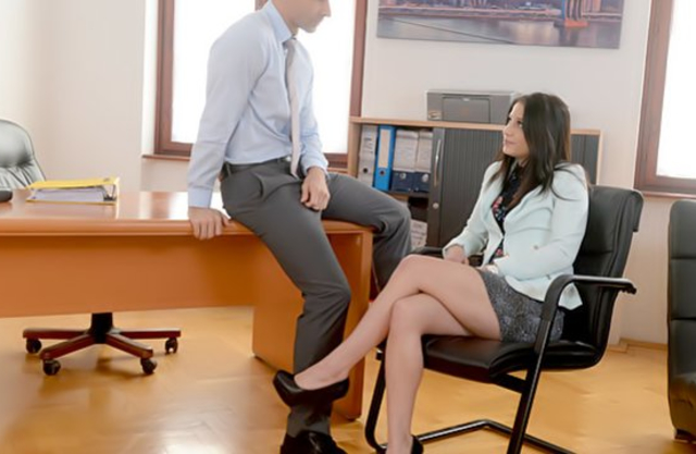 Brunette secretary gives boss blowjob and rides naked penis in office