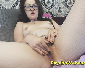 Nerdy girl in fishnet pantyhose plays with naked pussy on webcam
