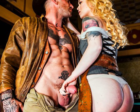 Handsome cowboy and slutty girl entwine naked bodies in empty bar