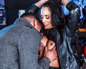 Stocky agent frees brunette and brings in garage for naked reward