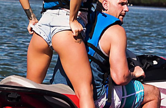 After watercraft ride bald guy has naked sex with two winning girls
