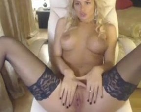Alluring blonde in black stockings strokes and rubs her amazing shaved pussy on cam