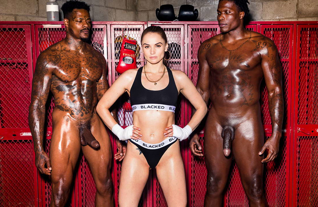Sexy sports reporter double teamed by two muscular black boxers at the gym