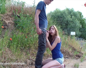 Girl is on her knees sucking naked cock then guy fucks her from behind