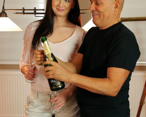 Older benefactor drinks champagne and penetrates girl's naked pussy