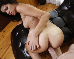Sexpot masturbates naked on daybed until it's time to gag on dick