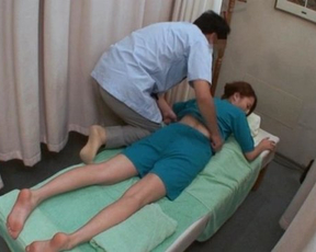 Asian masseur relaxes naked client by rubbing her twat with sex toy
