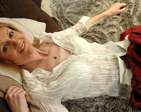 Mature cutie takes off clothes and has naked fun in the bedroom