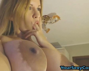 Busty woman with big nipples takes vibrator to pamper naked pussy