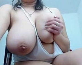 MILF shows how to give titjob stroking dildo with huge naked tits