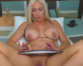 Sexy webcam model with naked boobies uses thick dildo to fuck herself