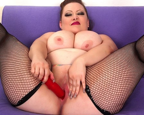 Busty big woman shows naked sexual aggression fooling around with vibrator