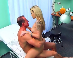 Doctor and naked blonde patient have unstoppable affair in cabinet