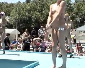 During festival naked girls aren't shy to walk seductively under sun