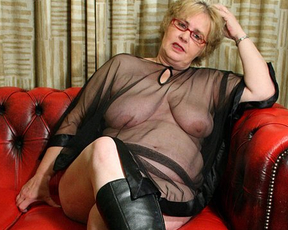 Some sex fantasies make naked granny eager to masturbate on couch