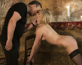 Master enjoys spanking slender naked blonde in stockings at his place