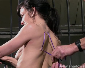 Experienced master dominates over naked woman with help of stapler