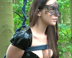 Busty lady in the mask and latex pants gets naked pussy toyed in nature