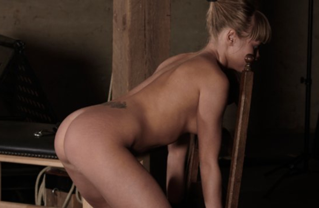 Naked lady leans on a chair being tied to it and gets fucked from behind