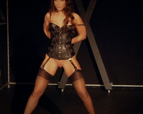 Lady in corset, stockings, garters and naked cunt meets the master