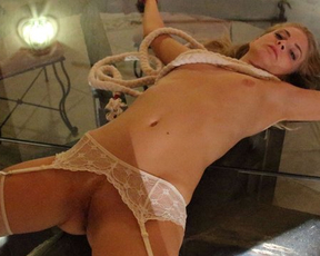 Naked blonde in white stockings with garters owned in doggystyle pose