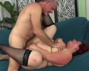 Naked red-haired BBW in stockings reaches orgasms fucking on the couch