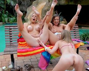 Three naked women enjoying a hot lesbian outdoor threesome