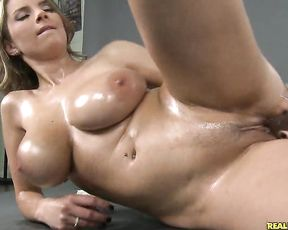 Sexy naked woman with huge tits fucking her pussy like mad