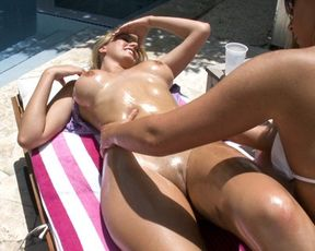 Three sexy naked girls by the pool
