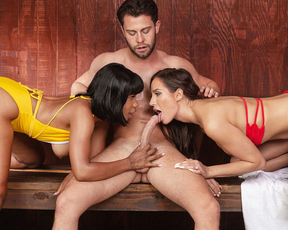 Brunette joins naughty ebony and her boyfriend for a threesome in a sauna