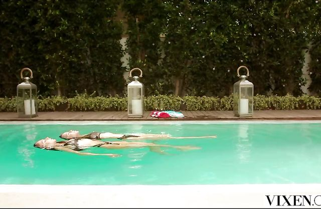 Two beautiful naked girls chill by the neighbor's pool and share his huge cock