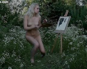 Skinny naked girl with a tight ass poses in front of her drawing easel outdoors