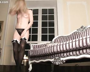 Elegant naked girl spreads legs on the sofa to expose her glorious pussy for the erotic movie